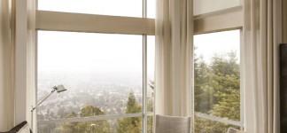 Modern corner sitting area cream curtain ideas for large windows with