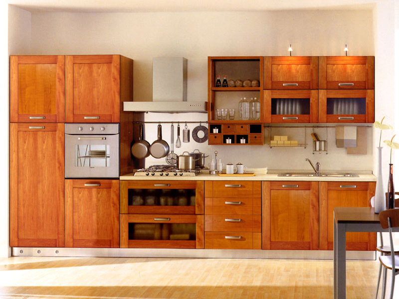Modern Kitchen Units Designs photo of a modern u shaped kitchen using floorboards from the