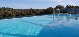 Pool fabulous modern style wooden lounge swimming pool melbourne equipped with small lawn area for Outdoor swimming pools melbourne