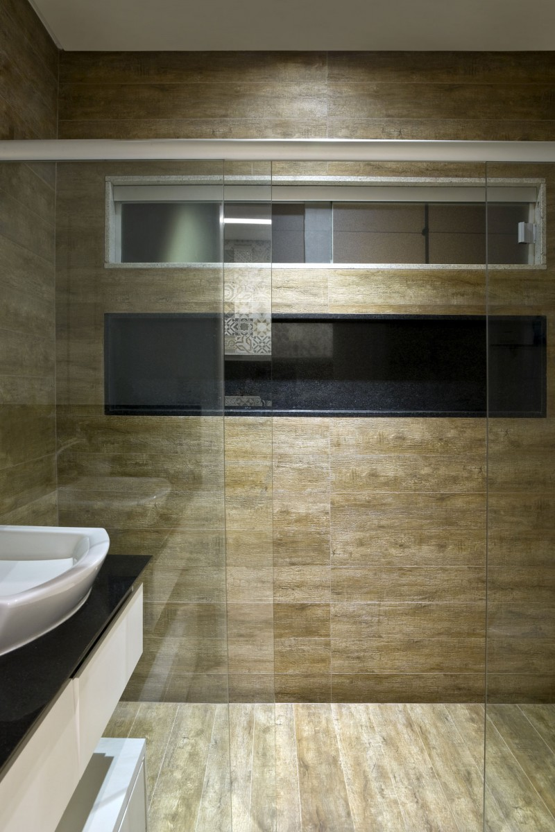 shower with glass sliding door granite tile backsplash at box house