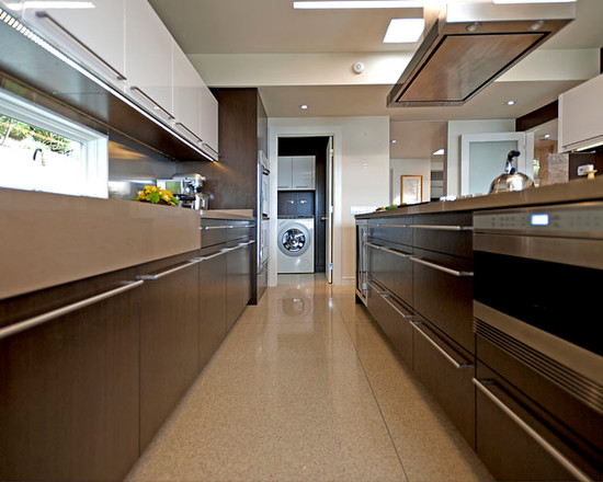 Modern galley kitchen design use granite flooring and ceiling lighting