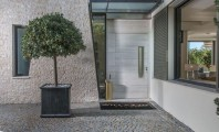 Interior and Exterior Design in Special White House Ideas : Sleek Contemporary Entrance With Stone Pavings And A Planter Modern Wooden Entry Door And Glass Window Also Stone Wall