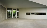Jazzy House Exterior Designed in Clean Lines : Alluring Open Car Garage Of Perfect OUTrial House With Sleek Curved Plastered Wall Offering Easy Way To Get The Entrance