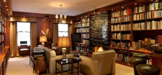 Mid Century House Design in Cozy Atmosphere: Cozy Living Room Decor Idea With Large Bookcase Design And Beautiful Fireplace At 142 Duane Street Penthouse Use Marble Mantel