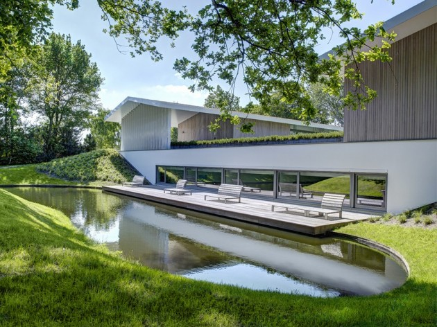 Modern Rural House Applying Futuristic and Open Style of House Living: Interesting L House Architecture With The Green Grass Yard And The Wooden Deck Near The Pool ~ claffisica.org Architecture Inspiration