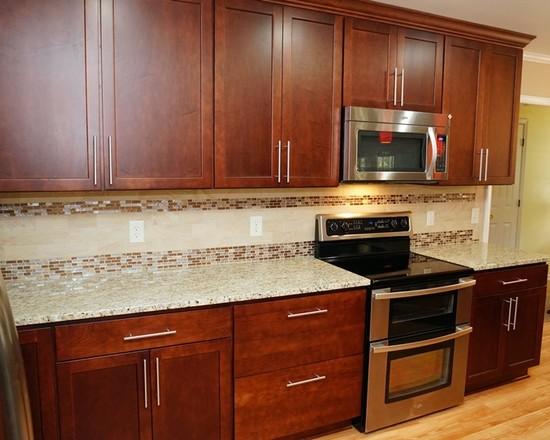 with darkwood cabinet and travertine tile backsplash and white oak