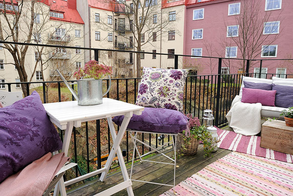 scandinavian apartment balcony design with traditional patio furniture
