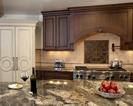 backsplash with cream tiles and artwork displayed and accentuated by
