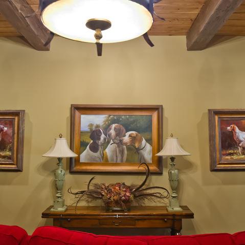 lodge basement lounge area with warm animal potraits as room wall art