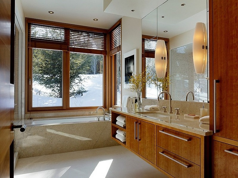 Bathroom design with wooden floating vanity design at carney logan