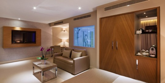 Luxurious Hotel Interior Décor with Clean Lining: Chic Modern Suite Room At The Orchid Reef Hotel With Minimalist Living Room Furniture With Cream Sofa And Small Coffee Table