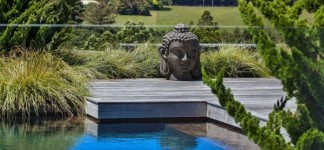 Contemporary Hill Home with Beautiful Gardens and Pool: Fantastic Buddha Statue In Pool Design Used Wooden Deck Flooring Decorated With Green Landscaping Design Ideas For Home Inspiration To Your House
