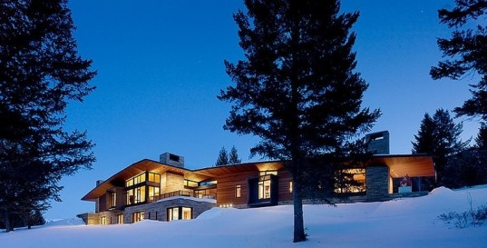 Irresistible Wooden House with Scenic View to Enjoy: Modern Mountain House View From Distance At Winter Night With Pines And White Snow Surrounded The Carney Logan House