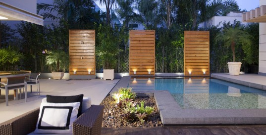 Wonderful Dream Shelter with the High Standard of Architectural: Charming UBHouse Design In Outdoor Space With Minimalist Modern Pool Decoration Completed With Modern Lighting Design Ideas For Home Inspiration