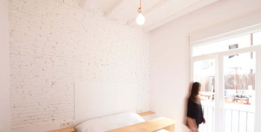 Cool Minimalist Apartment Design with Contemporary Touch: Fascinating Bedroom Inside The Raval Hideout With Exposed White Brick Wall And Wooden Bed Near Glass Windows