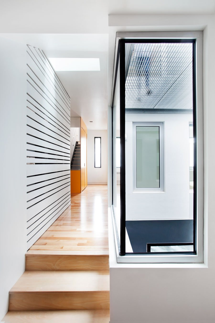 Wonderful Contemporary Home Idea with Amazing Color Choice: Stylish Stairs Design In Hallway Decorated With Wooden Flooring And White Wall Color Design Ideas For Home Inspiration